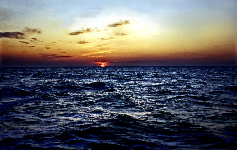 Golden Sunset Over Deep Blue Ocean