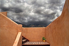 Clouds And Mountains Over Adobe Stairs