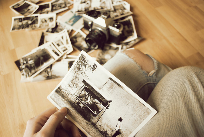 Diary, photos, and a bookmark to memories