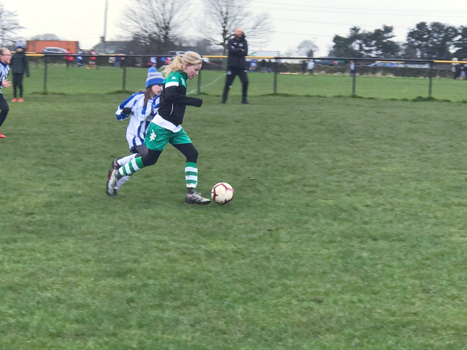Young female football player with football