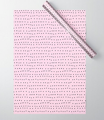 tiny black dots on pink gift wrap by Ashley Rice
