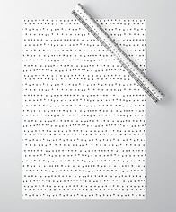 tiny black dots on white giftwrap by Ashley Rice