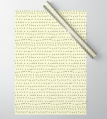 tiny black dots on cream gift wrap by Ashley Rice