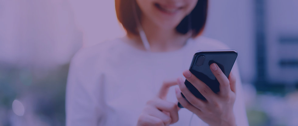 smiling-asian-woman-using-smartphone-with-listening-to-music-and-standing-in-office-buildi