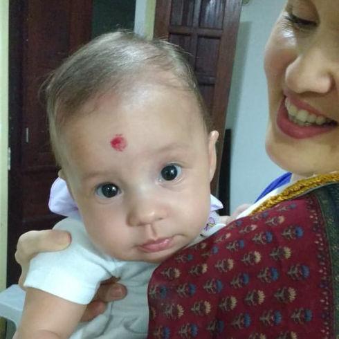 Baby Sahaja. First 3 month old puja.jpg