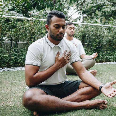 A group of Malaysian yuva shaktis medita