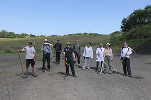 Volunteer group happy with the training on how to scythe.JPG