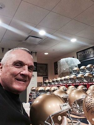 Rudy with helmets.jpg