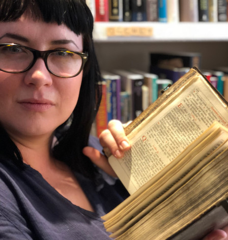 Vanessa Brown with antiquarian book