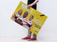 Free PSD of a Man Holding a Poster Mocku