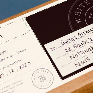 white peak postage label