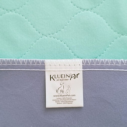 Soft quilted, absorbent materials. Waterproof bottom layer