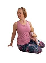 Norah Nelson yoga twist with baby.jpg