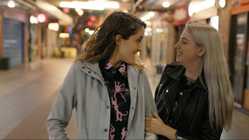 "Real life lesbian couple Grace Mitchell and Alyssia Ciccarello star in the video for marriage equality song ""Love Is Love."""