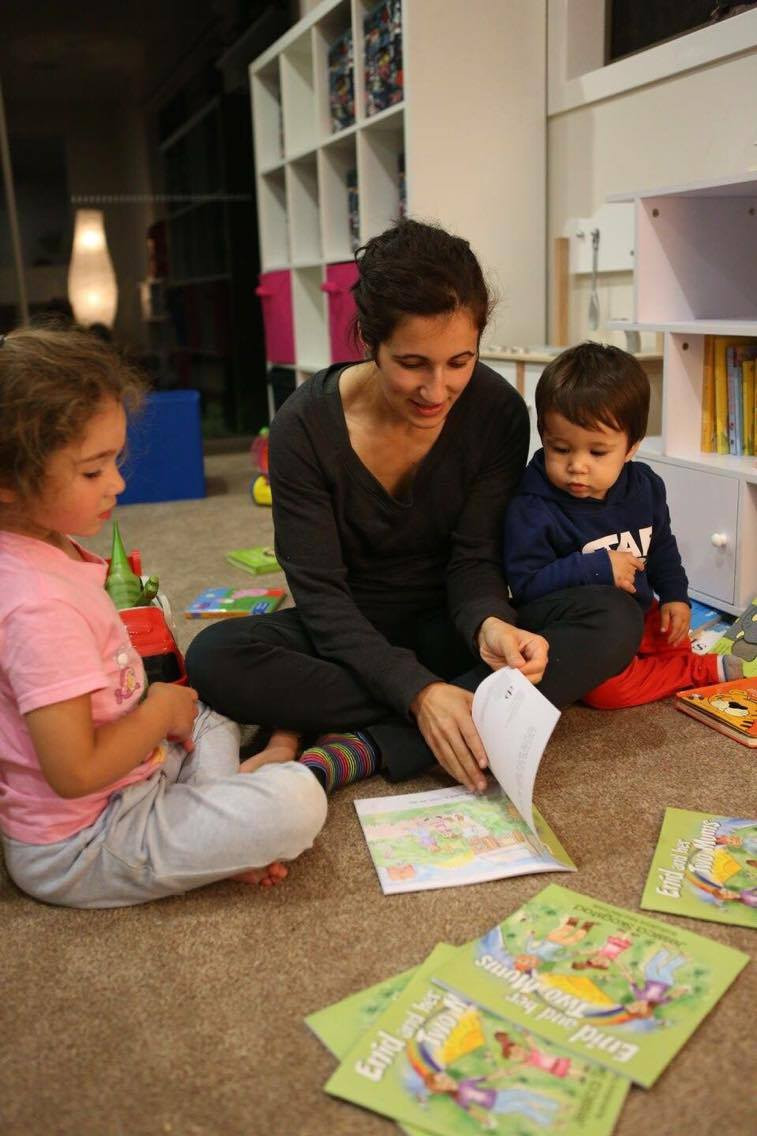 Kids reading Enid And Her Two Mums: the children's book that celebrates diversity.