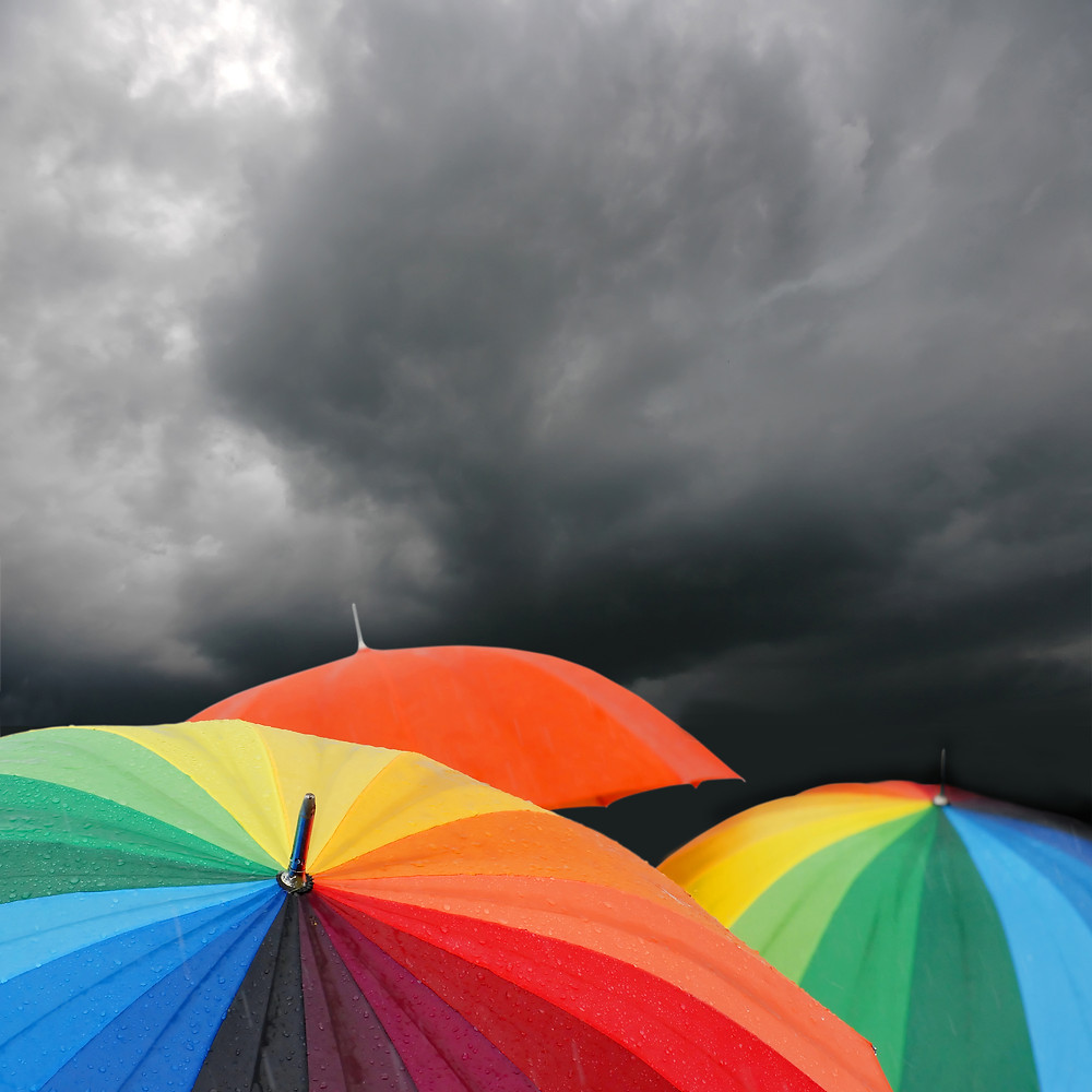 Rainbow umbrellas surrounded by clouds. On #WorldMentalHealth day opposition leader Bill Shorten asks Aussies to help their LGBTIQ mates through the marriage equality postal survey.