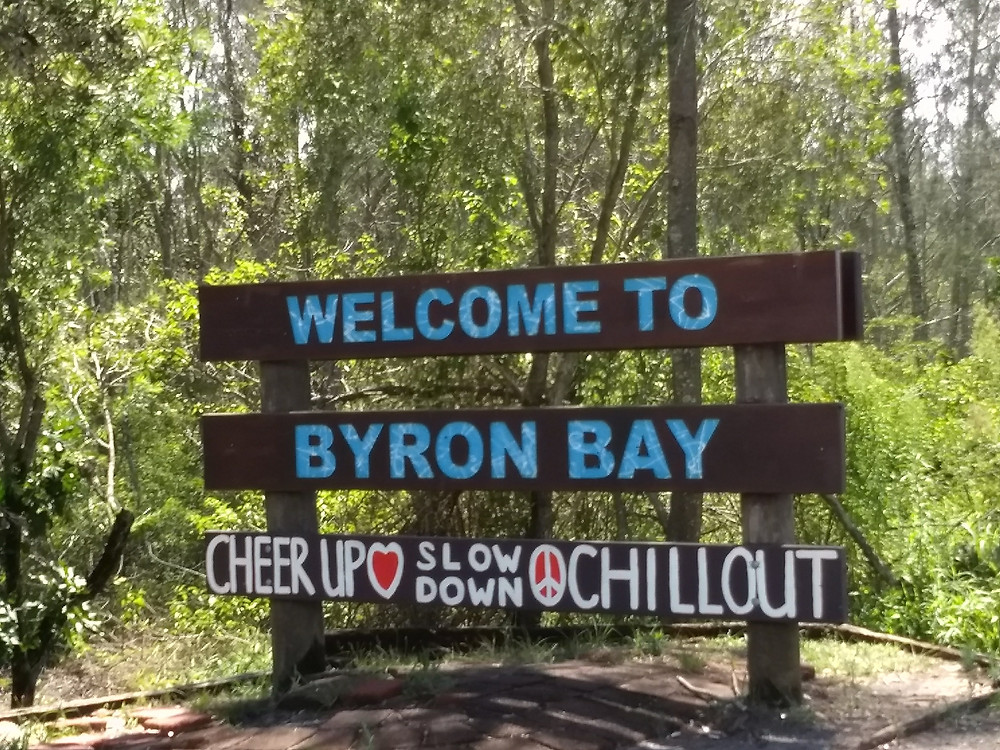 The sign on the way into Byron Bay urging visitors to cheer up, slow down and chill out.