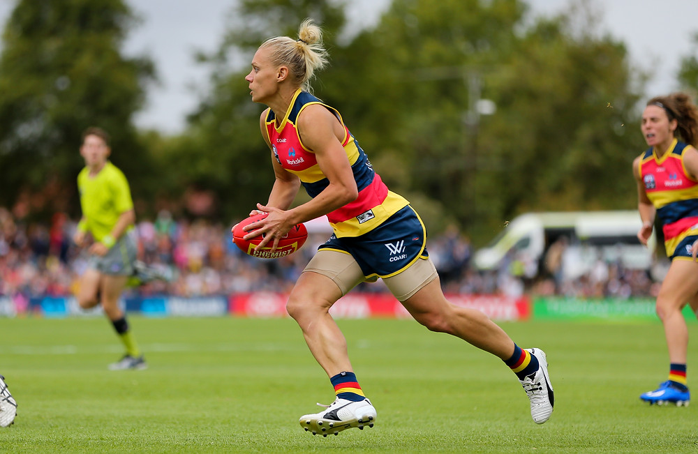 AFLW superstar Erin Phillips will bring her wife & twins back to Adelaide next season as she's signed on again with the Adelaide Crows