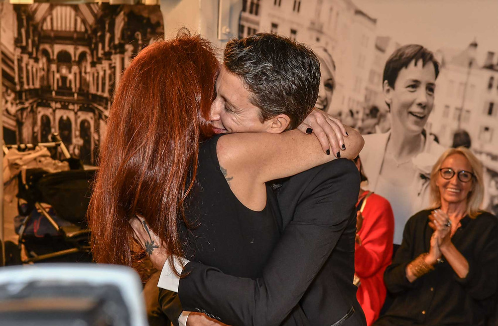 Lesbian art duo JF Pierets hug after performing wedding no 3 for marriage equality project '22'.