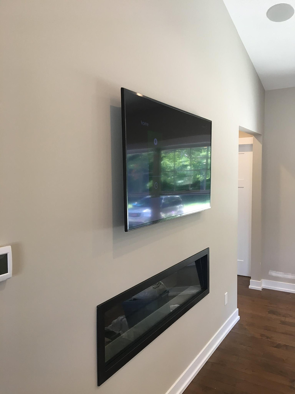 Flat screen OLED TV installation in home media room