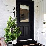 front door with tree