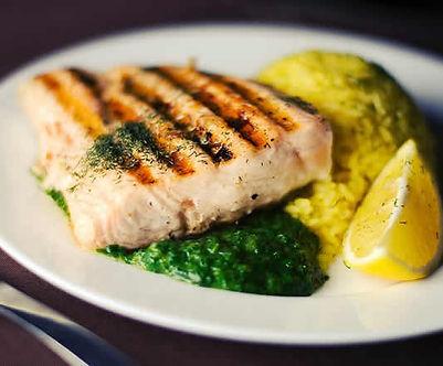 Fish dish w/green sauce and lemon