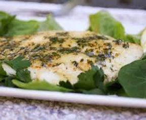 Closeup of fish w/herb sauce.