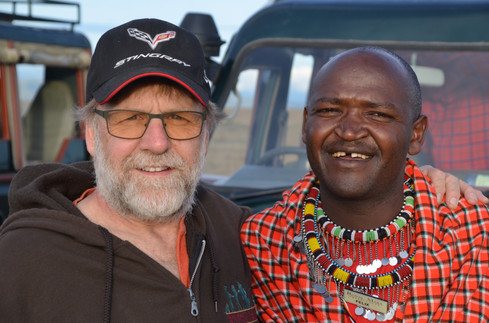 Larry with Maasai warrior at the Royal Mara.jpg