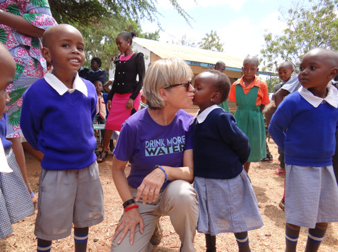 Dr. Susan Grimes getting a kiss at Makindu Children's Center. Tom Thompson