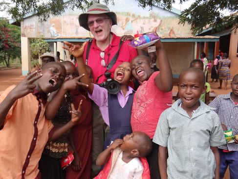 Photographer Bob Pool with MCC children. Marcia Moore