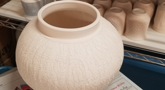 Unglazed pot with bark texture.