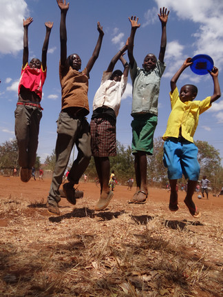 Children playing frisbee at Makindu Children's Center. Marcia Moore