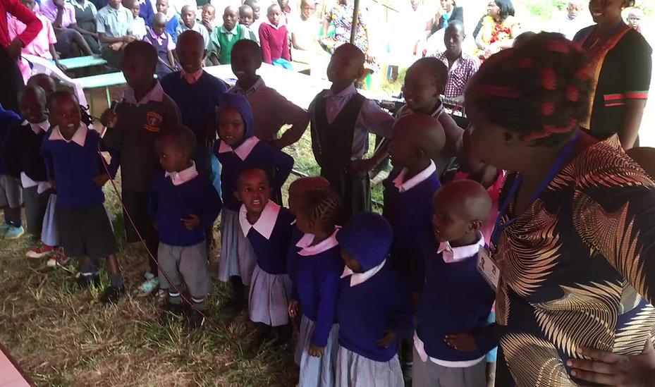 Children of the Makindu Centre chanting and dancing.