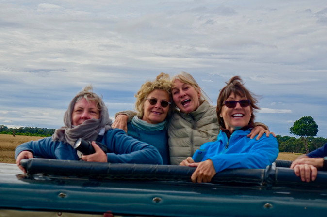 Nikki, Nita, Marcia, and Cathy in Landcruiser on safari with Royal Mara. .jpeg