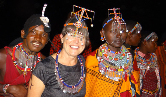 2.	Cathy with Maasai dancers. Marcia Moore