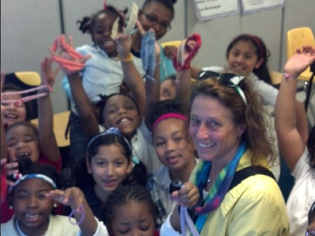 Julie Bartos & The kids at the Nehemiah Center!