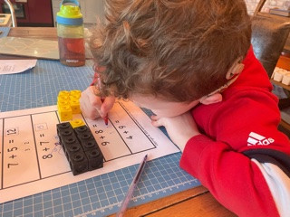 A pupil in Dolphin class (Y1) uses his knowledge of number bonds to complete addition calculations.