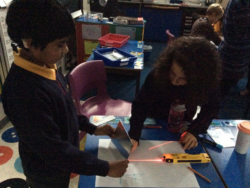 In Science, Y4 Penguins investigate how light reflects off different surfaces.