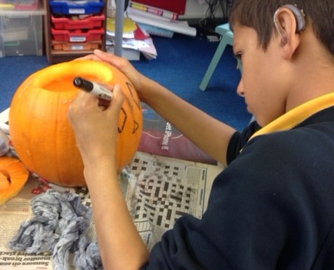 Happy Halloween from Year 6 - carving pumpkins! Great fun!