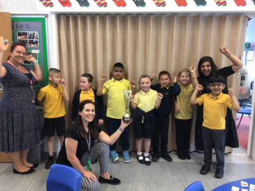 Key Stage One children won the orienteering competition. This is Year 2 receiving the trophy.