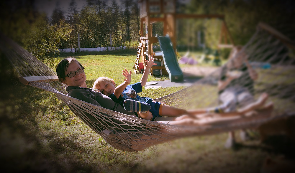Mother and 4 year old son in a hammock