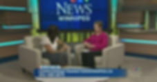 Photo of two women on a news show interview seated facing one another in conversation