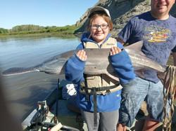 Olivia Albrecht with a 30 pound padddlefish