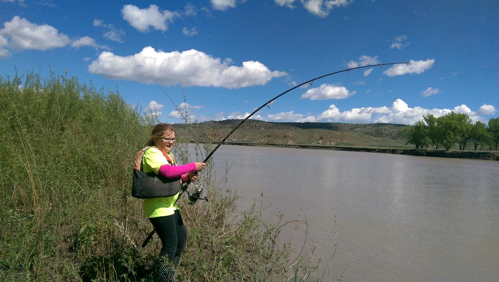 Olivia Albrecht paddlefishing