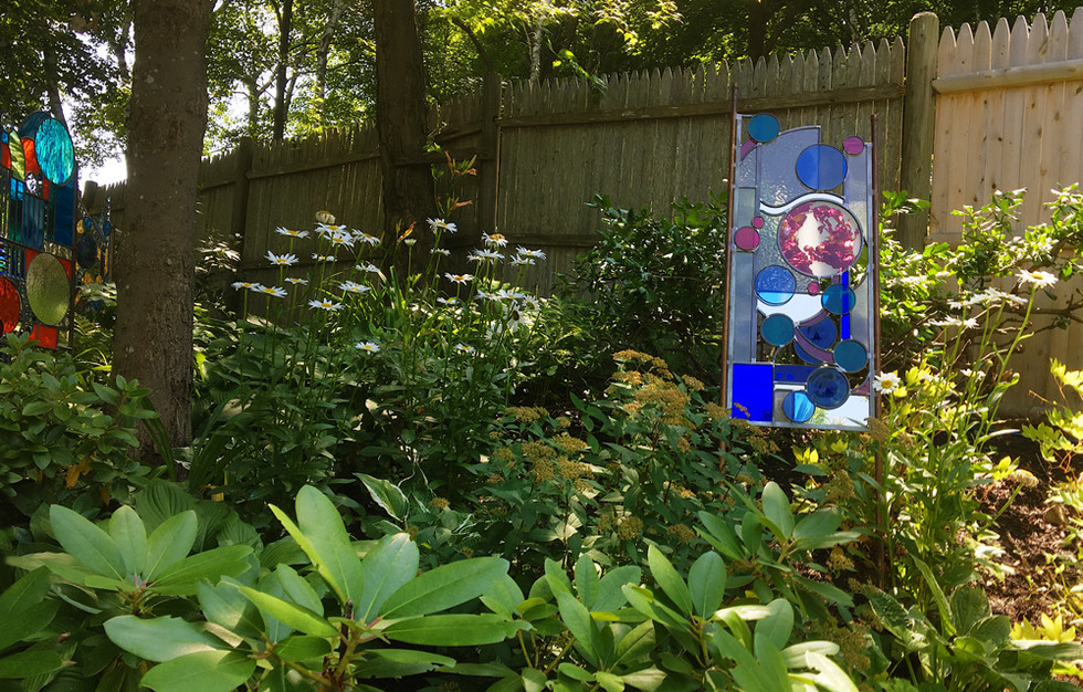 A Duo of Glass Sculptures in the Garden