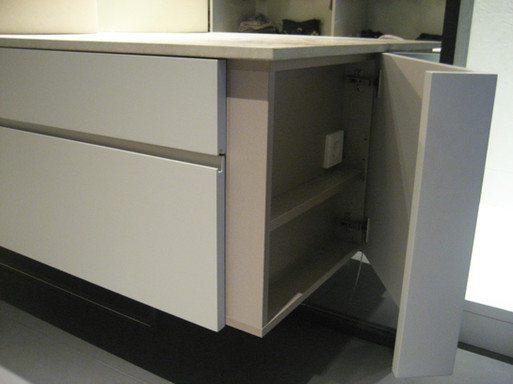 Custom bathroom cabinetry incorporating hiding electrical outlets and toiletry storage