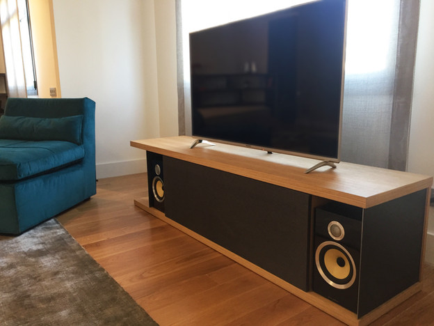 Custom televion furniture incorporating speakers and hiden cables and other electrical components