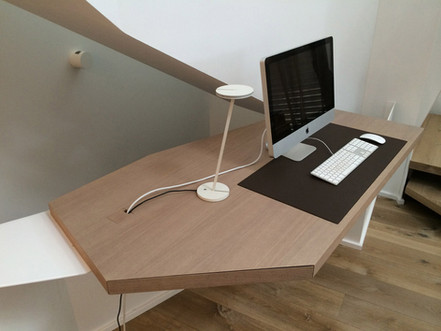 Custom office furniture designed for small, unusual spaces where a ready-made desk isn't an option