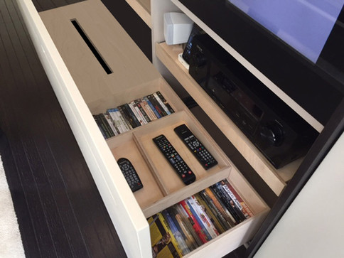 Custom drawer partitions for storing remote controls, video games, and other home entertainment elements