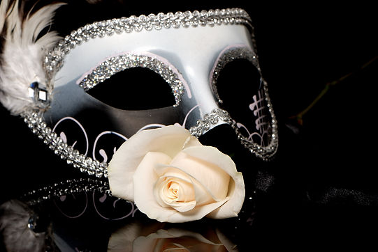 The Venetian mask and flower on a black